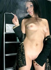Nude young smoking brunette