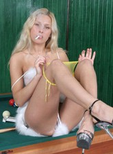 Super blonde teen playing pool and smoking