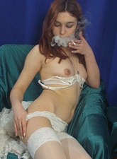 Nude smoking chick in see-through dress