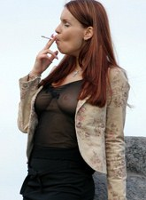 Sexy busty teen smoking outside