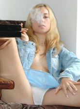 Amateur brunette smoking at home
