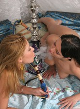 Nude passionate girlfriends smoking hookahs