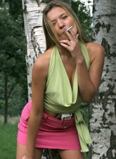 Young smoking hottie in the park