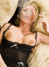 Smoking topless blonde lady