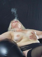 Nude blonde bitch with big tits smoking